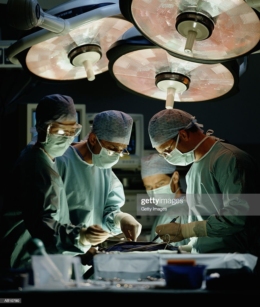Surgeons performing surgery : Stock Photo