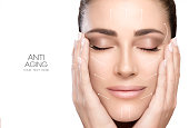 Anti aging treatment and plastic surgery concept. Beautiful young woman with hands on cheeks and eyes closed with a serene expression and white arrows over face. Perfect skin. Portrait isolated on whi