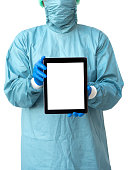 Surgery doctor in uniform holding tablet with isolated screen on white background, medical concept