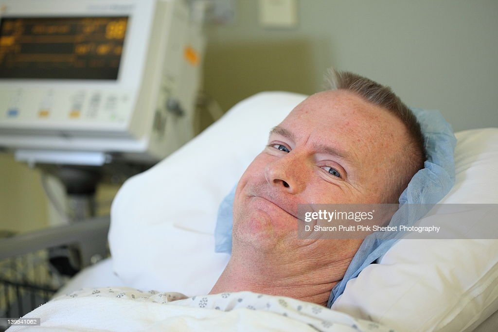 Surgery post-op recovery room man smiling : Stock Photo