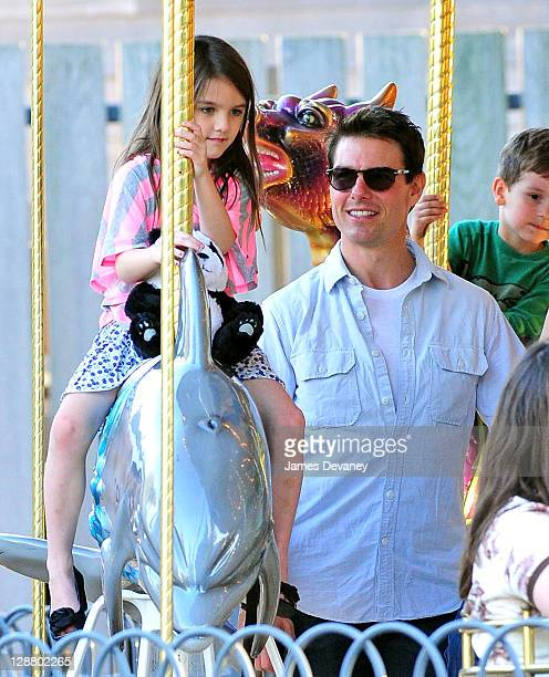 Suri Cruise and Tom Cruise visit Schenley Plaza's carousel on October 8 2011 in Pittsburgh Pennsylvania