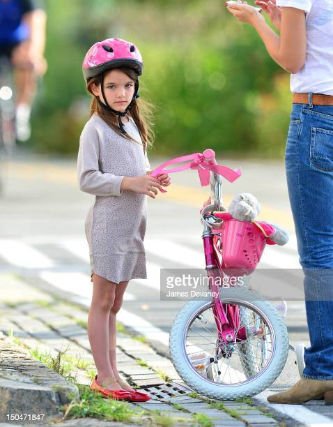Suri Cruise goes for a bike ride along Manhattan's West Side bike path on August 18 2012 in New York City