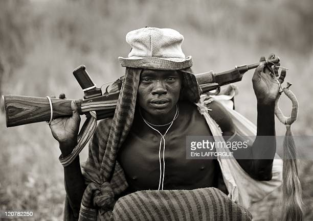 Suri man with a Kalashnikov in Omo valley Ethiopia on July 05 2010 Surma or Suri are sedentary pastoral people living in south west of Ethiopia on...