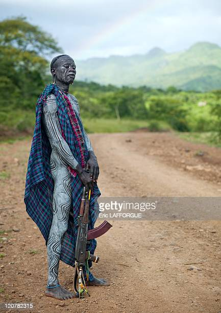 Suri man with a Kalashnikov in Turgit village Omo valley Ethiopia on July 03 2010 Surma or Suri are sedentary pastoral people living in south west of...