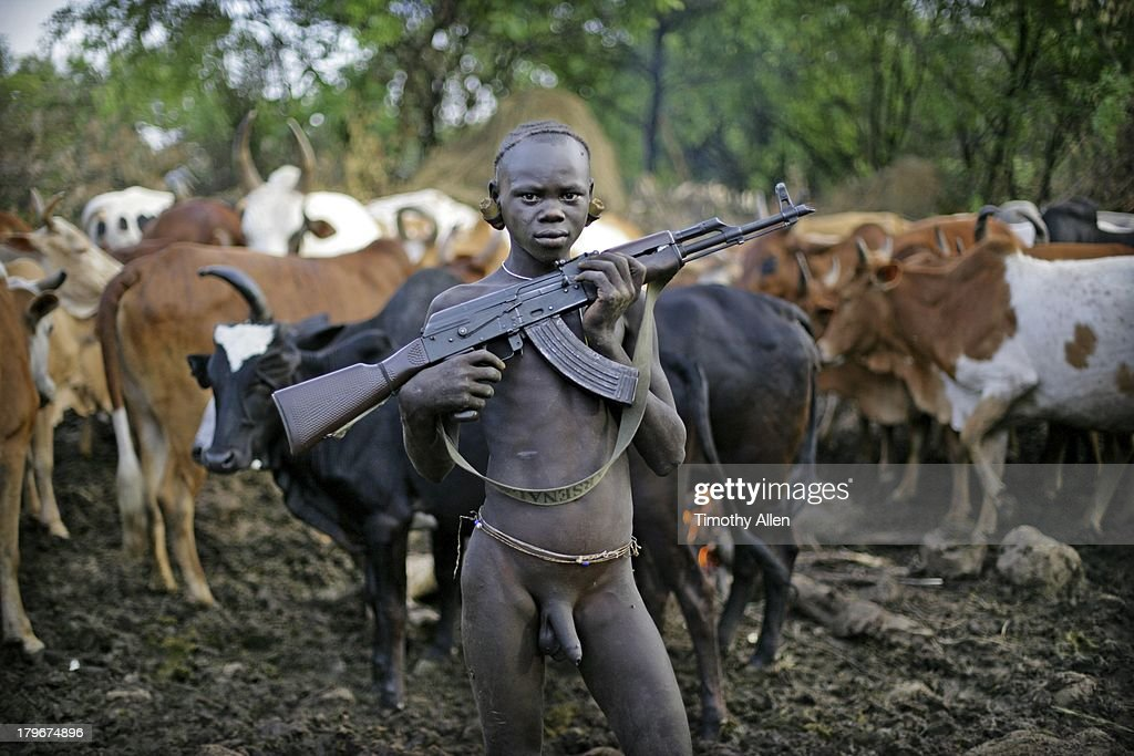 African tribe boys cow sex