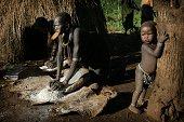 Suri tribal family working outside village hut