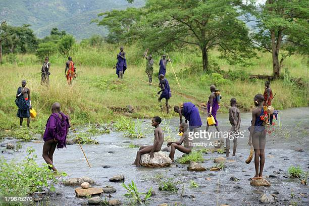Suri tribe collect water from river, Omo Valley