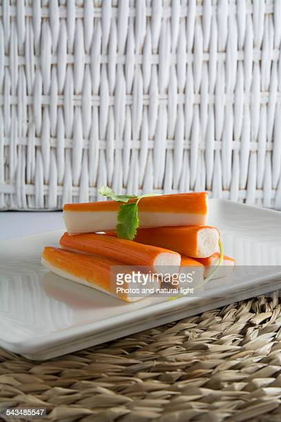 Surimi or crab sticks in a white rectangular plate