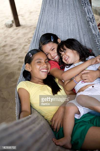 Suriname, Galibi.  Children in Hammock.