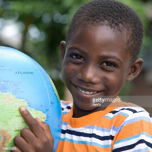 Suriname, pointing at a globe.