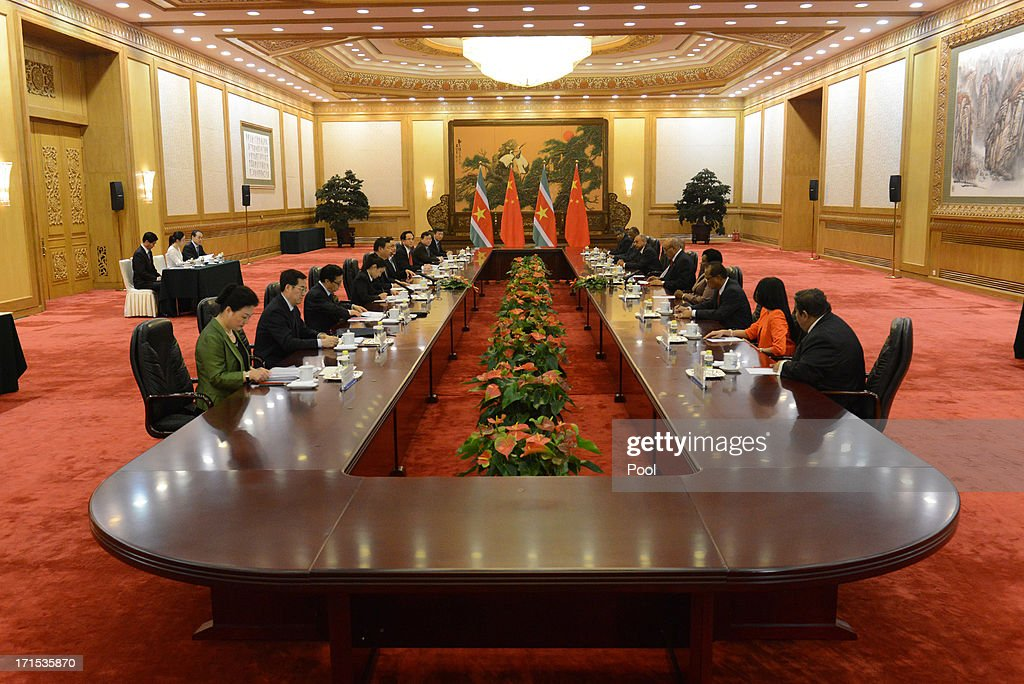 Suriname President Desi Bouterse (C, R) meets with Chinese President Xi Jinping (C, L) at the Great Hall of the People on Jun 26, 2013 in Beijing, China. Desi Bouterse is on a visit to China from Jun 24.
