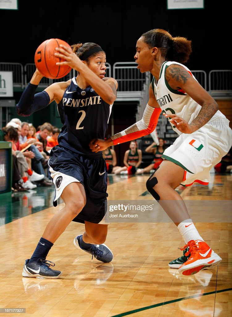 Suriya McGuire #33 of the Miami Hurricanes defends against Dara Taylor #2 of the Penn State Lady Lions on November 29, 2012 at the BankUnited Center in Coral Gables, Florida. Miami defeated Penn State 69-65.