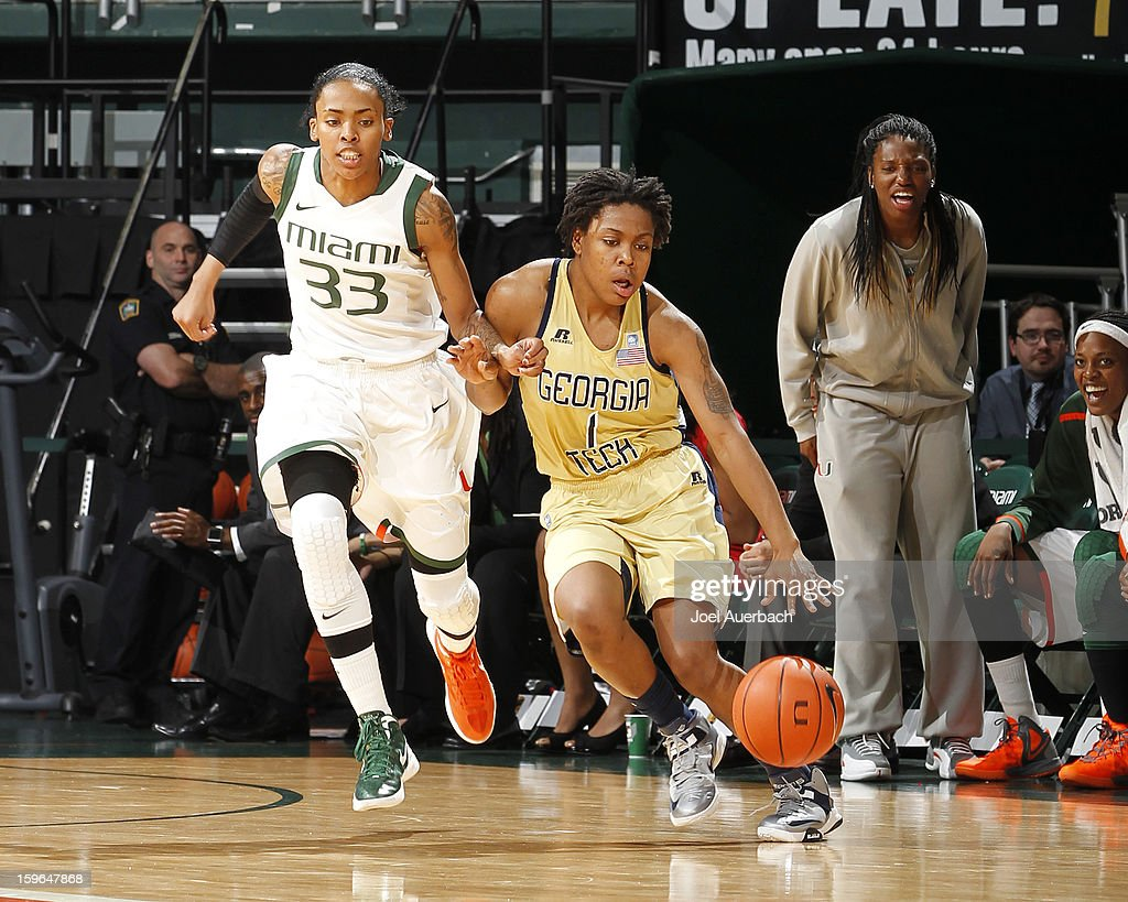 Suriya McGuire #33 of the Miami Hurricanes defends against Dawnn Maye #1 of the Georgia Tech Yellow Jackets as she dribbles the ball on January 17, 2013 at the BankUnited Center in Coral Gables, Florida. Miami defeated Georgia Tech 71-65.