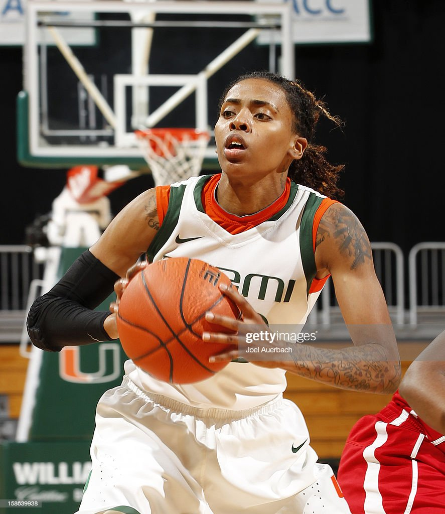 Suriya McGuire #33 of the Miami Hurricanes passes the ball against the North Carolina State Wolfpack on December 20, 2012 at the BankUnited Center in Coral Gables, Florida. The Hurricanes defeated the Wolfpack 79-53.