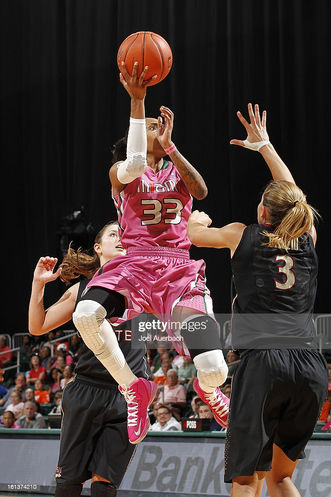 Suriya McGuire #33 of the Miami Hurricanes shoots the ball against Alexa Deluzio #3 of the Florida State Seminoles on February 10, 2013 at the BankUnited Center in Coral Gables, Florida.