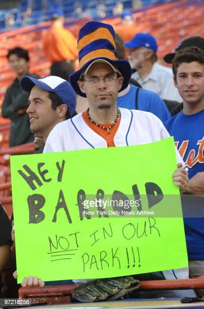 A surly looking New York Mets fan holds a sign reading 'Hey Barroid not in our park' referring to San Francisco Giants' Barry Bonds' alleged steroid...
