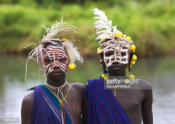 Surma kids decorated with fruit and herbs decorations in Kibbish Village Omo valley Ethiopia on July 05 2010 Body paintings unfortunately also show...