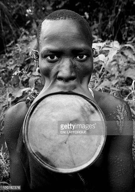 Surma woman with a huge lip plate in Kibbish village Omo valley Ethiopia on July 04 2010 Surma woman with a huge lip plate This labret means that the...