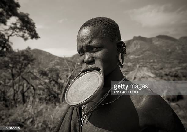 Surma woman with lip plate in Turgit village Omo valley Ethiopia on July 04 2010 Piercing and lip plates are a strong part of the Suri culture These...