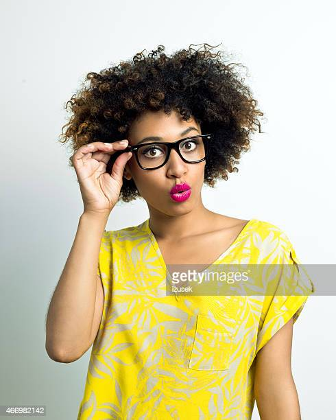 Surprised Afro Woman wearing glasses