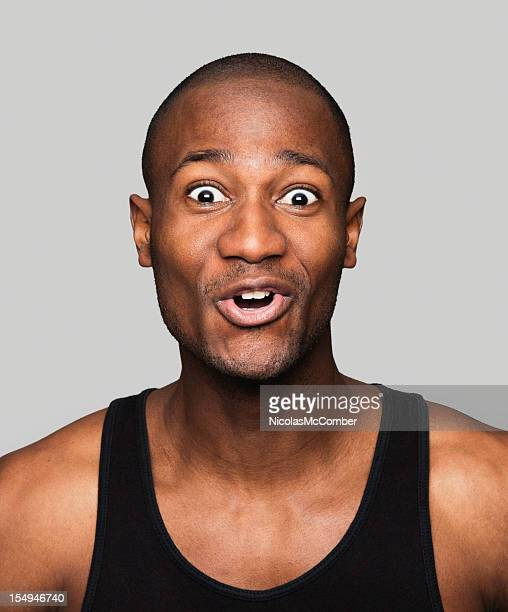 Surprised and delighted African American man