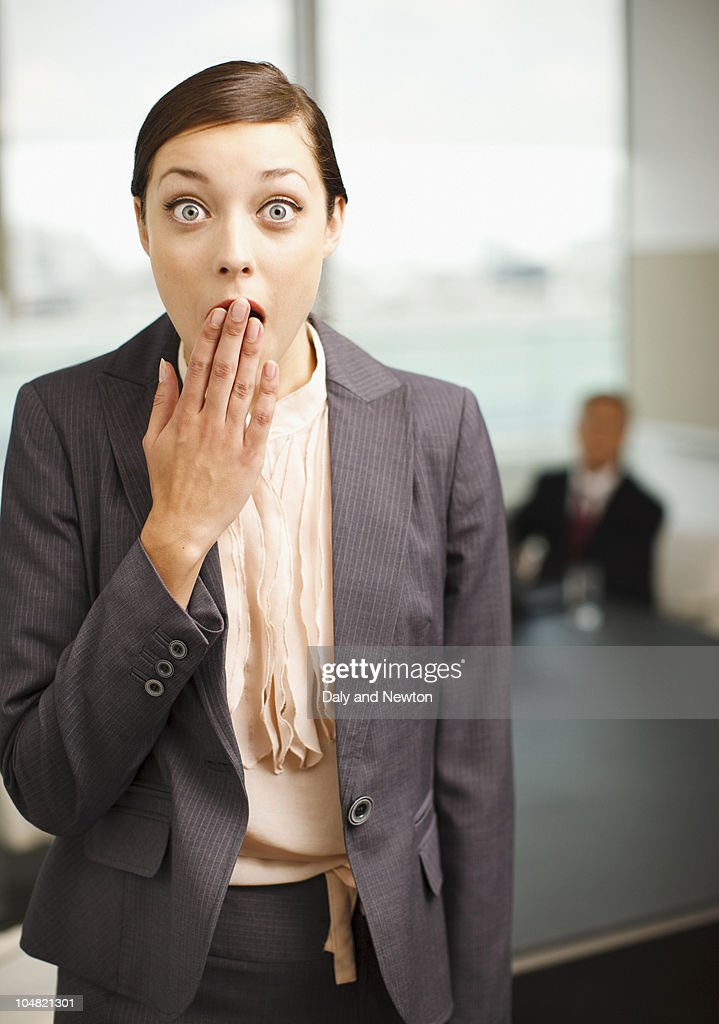 Surprised businesswoman covering mouth : Stock Photo