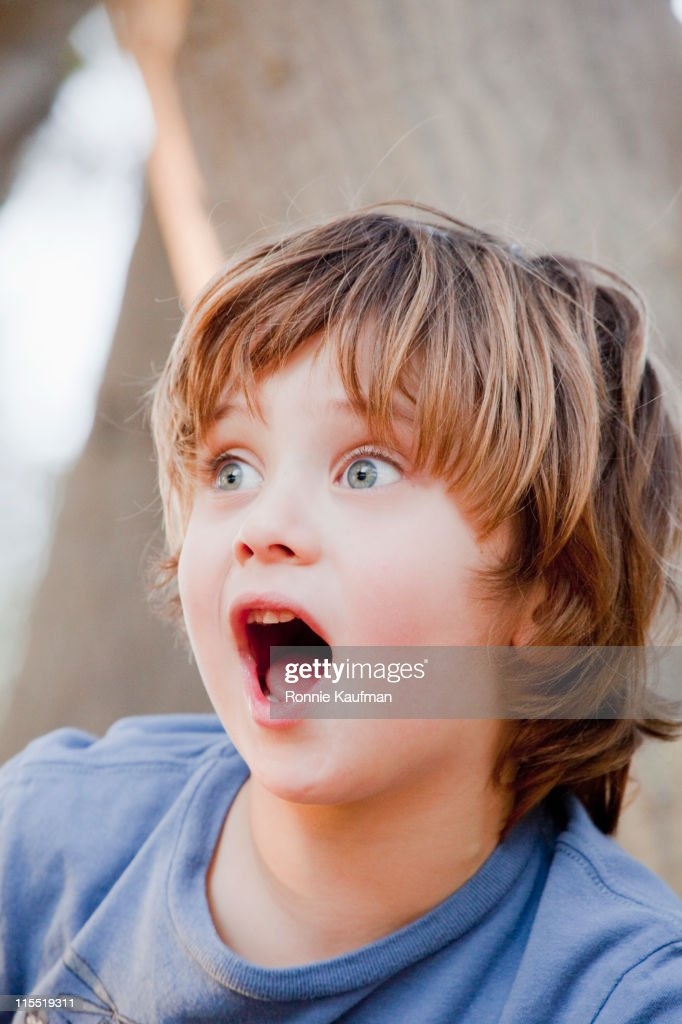 Surprised Caucasian boy : Stock Photo