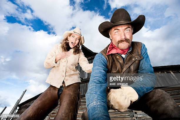 Surprised Cowgirl Watching Cowboy Work