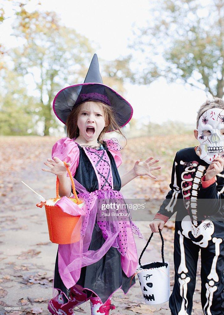 Surprised girl in Halloween costume : Stock Photo