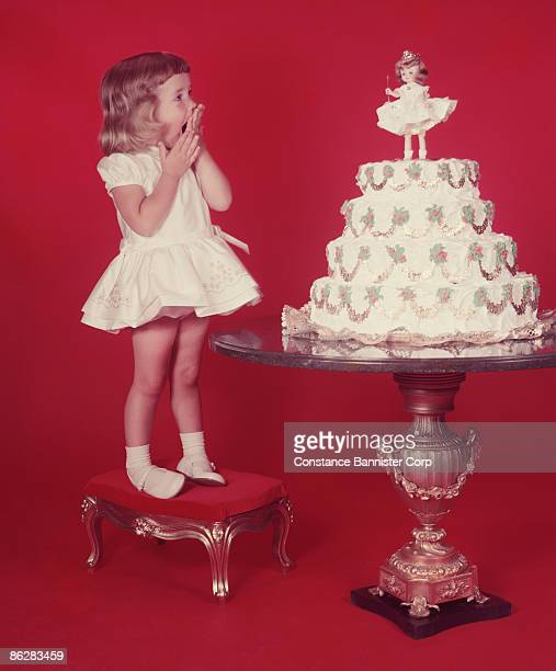 Surprised girl looking at decorated cake
