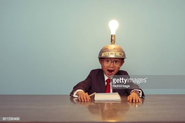 Surprised Japanese Business Boy Wearing Lit Up Thinking Cap
