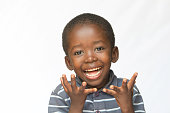 Isolated on white. Surprised Little African boy making a facial expression. Here he is acting surprised.