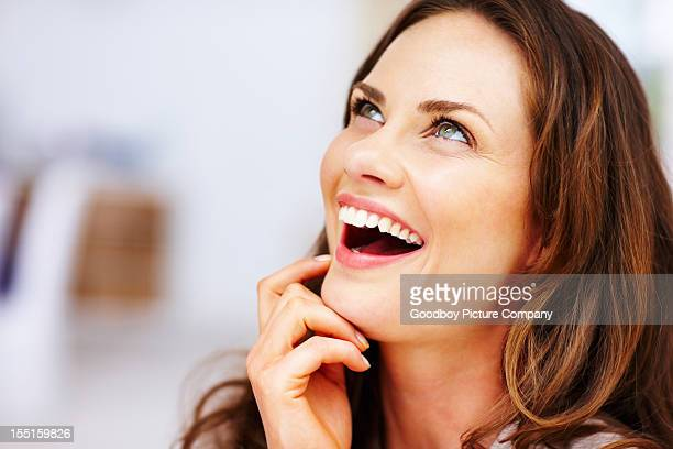 Surprised middle-aged woman looking up