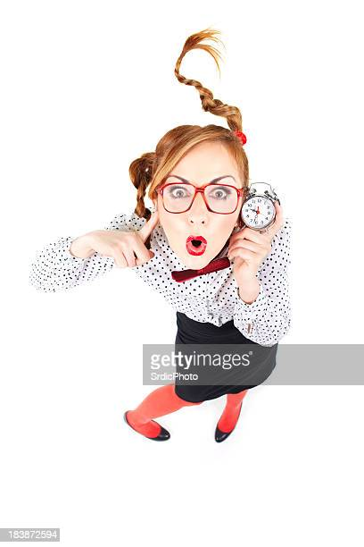Surprised Nerdy businesswoman holdin small clock