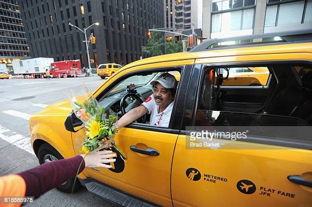 Surprised New Yorkers are greeted with flower bouquets and smiles by the Society of American Florists in an effort to 'petal it forward' keep one...