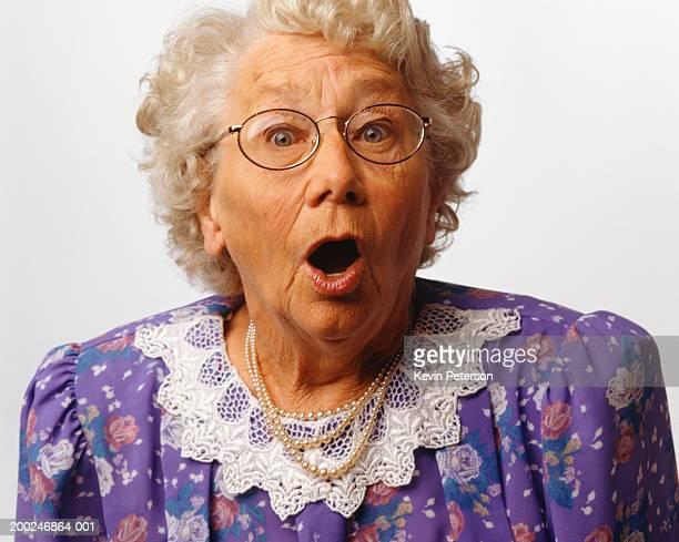 Surprised senior woman, posing in studio, (Portrait)
