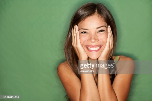 Surprised woman on green background. : Stock Photo