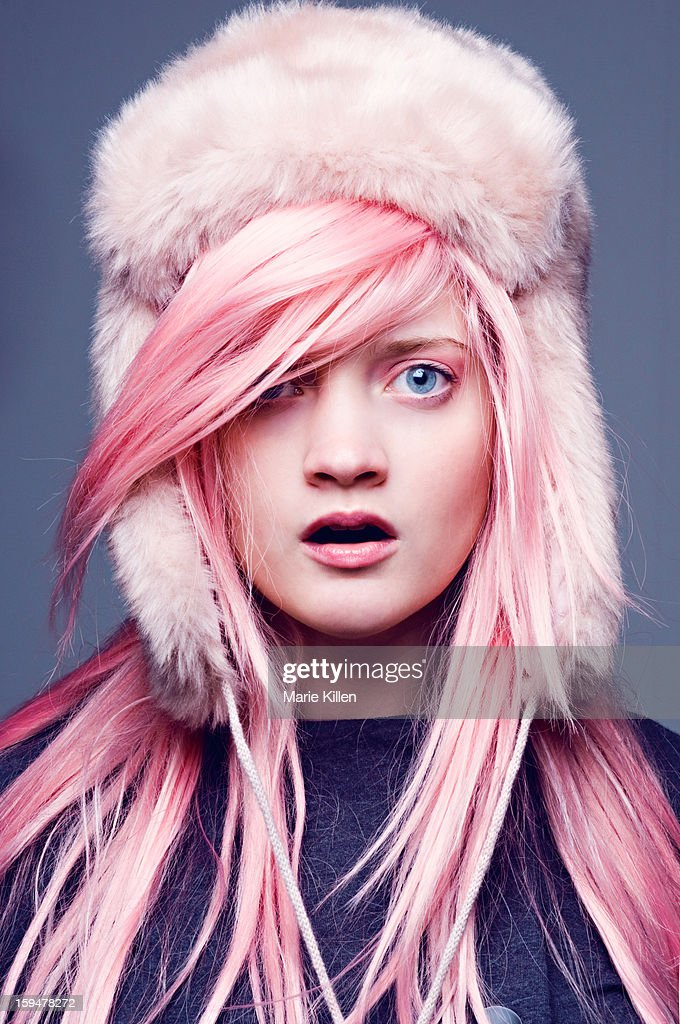 Surprised woman with pink hair and pink furry hat : Stock Photo