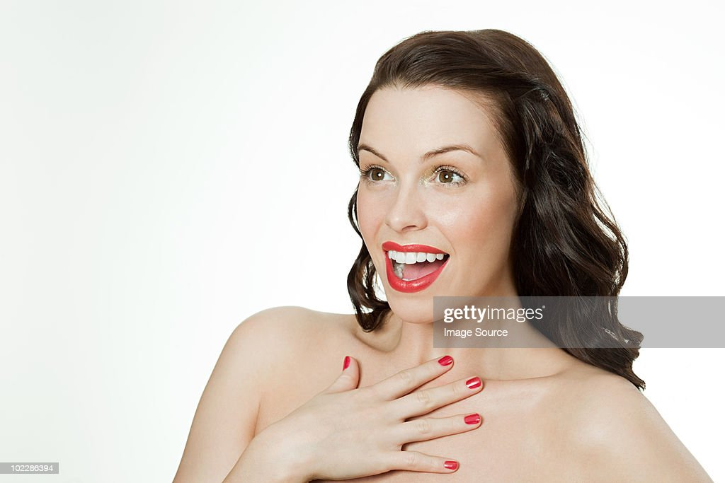 Surprised young brunette woman : Stock Photo