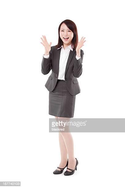 Surprenant Belle femme d'affaires sur un arrière-plan blanc