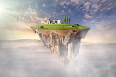 Fantasy island with idyllic landscape levitating in the air at sunny morning. Ecology concept.