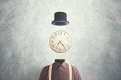 surreal man clock on head time concept