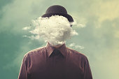 man with bowler with cloud over his head