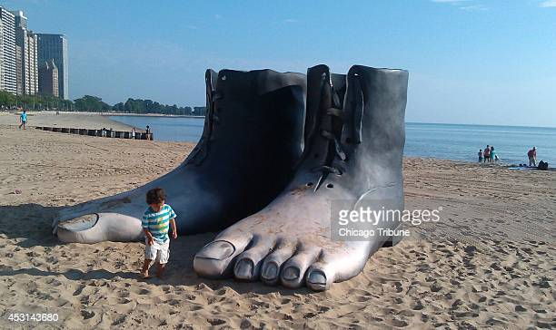 A surreal sculpture of feet molded into a boot resembling a painting by artist Rene Margritte titled 'Le Modele Rouge' is placed in the middle of the...