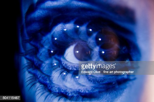 Surrealist multiple image of young lady's eye : Stock Photo