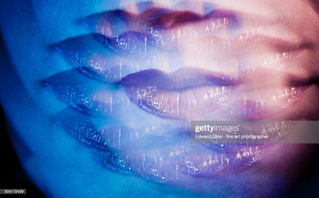 Surrealist multiple image of young lady's red lips : Foto de stock