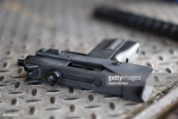 A surrendered TEC9 style gun is seen at a gun buyback event that was announced by Los Angeles Mayor Eric Garcetti in the wake of a killing spree at...