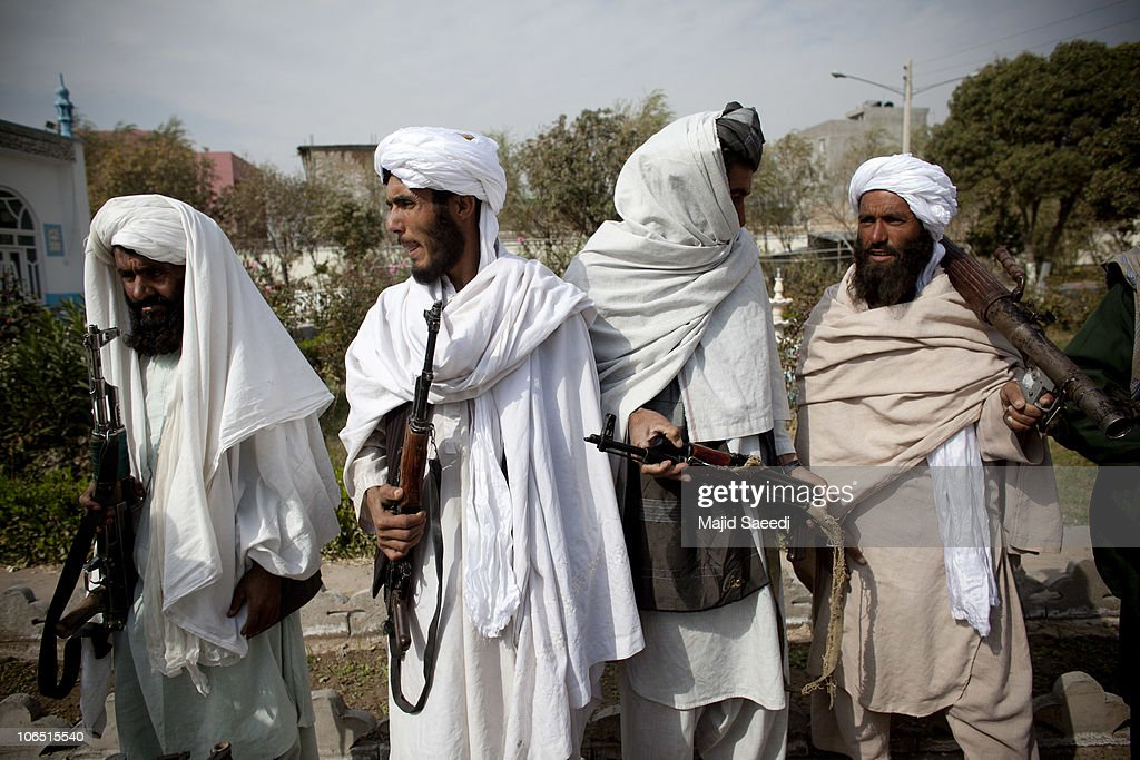 Surrendering Taliban militants stand with their weapons as they are presented to the media on November 4 2010 in Herat Afghanistan Twenty Taliban...