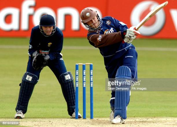 Surrey batsman Ali Brown plays a shot as Kent wicketkeeper Niall O'Brien looks on during the Cheltenham Gloucester Trophy match at the St Lawrence...