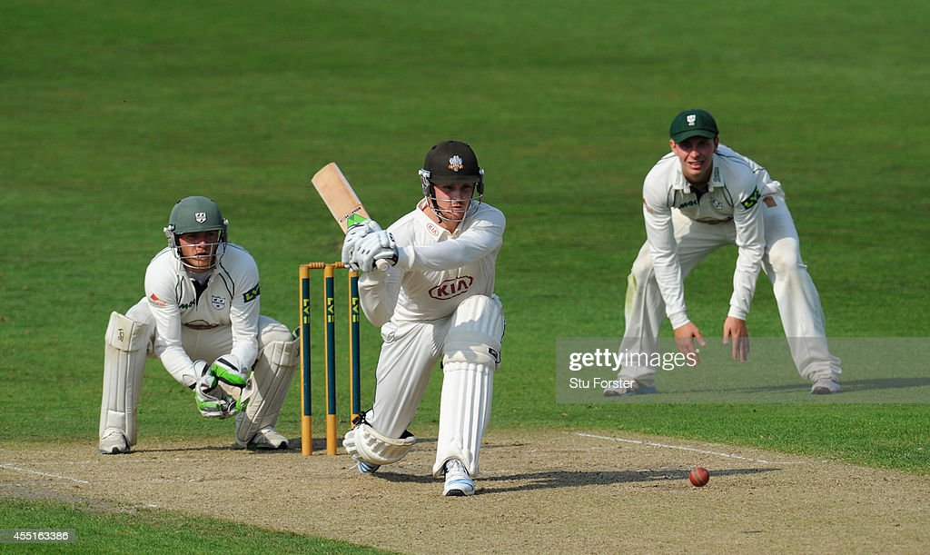 Surrey batsman Jason Roy picks up some runs watched by wicketkeeper Ben Cox during day two of the LV= County Championship Division Two match between...